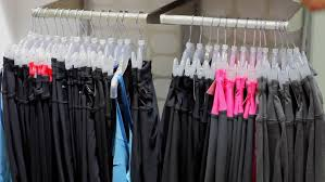 Laundry Room Hangers - clean clothes on hangers in the laundry room stock footage video