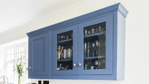 kitchen storage solutions and kitchen must haves for a busy glass display cabinet pin it