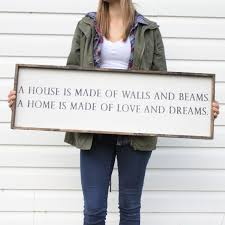 a house is made of walls and beams wood sign farmhouse signs