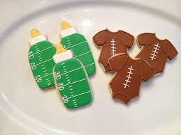football baby shower baby give cookie
