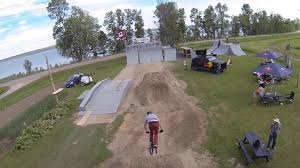 video motocross freestyle extreme sport freestyle bmx jump shot from helicopter drone