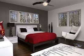 grey accent wall bedroom contemporary with above shelf lighting