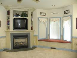 unique fireplaces village design two sided stone corner fireplace familyliving