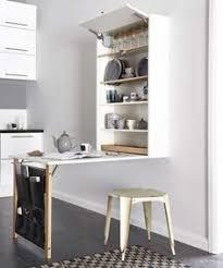 table escamotable dans meuble de cuisine astuces déco pour agrandir une cuisine table escamotable