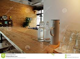 bottle of water on long table in coffee shop stock photo image