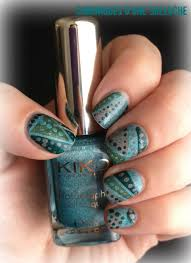 dots over geometric nail art design in muted fall colors manis 2