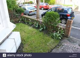 small front garden of a traditional victorian terrace house stock