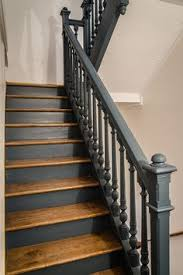 Best Paint For Stair Banisters Love The Charcoal Grey Color Of The Stairs Against The White Walls
