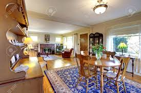 old country english charm living and dining room with blue rug