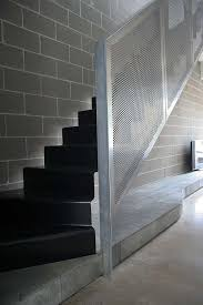 floating steel treads with perforated metal balustrade stairs