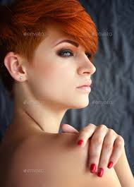 woman with short hair portrait of a beautiful young red haired woman with short hair o