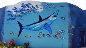 seaworld orlando mako review coaster chit chat guy harvey s beautiful mural on the outside wall of mako s gift shop