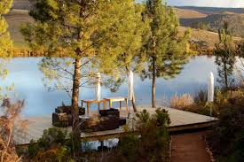 wooden deck lake view old mac daddy luxury trailer park in