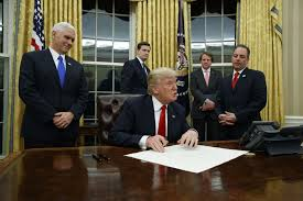 trump signs first executive order as president pennlive com