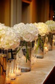 white flower centerpieces create a fresh and lovely ambiance with white flower centerpieces