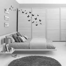 white bed design plans mirrored table lamp dark grey floor tiles