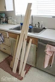 white kitchen cabinets with window trim adding trim around kitchen window