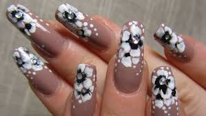 elegant beige one stroke flower design in black and white nail art