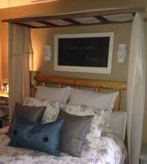 an old ladder re purposed as a bed canopy canopy bedrooms and