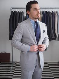 what color shirt with light grey suit of the week printed silk and bold color ties dress like a