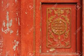 Red Door Paint by Wooden Chinese Symbolic Carving On Old Wood Door The Red Paint