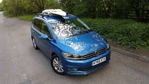 old blue volkswagen vw touran flexible and fuss free parkers