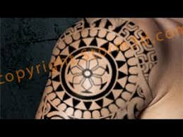 polynesian tribal shoulder with mask and sun design