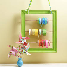 ribbon spools creative way to store spools of ribbon using a picture frame and