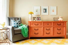bedroom nursery room design with white fabric rug with orange