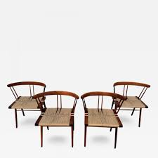 george nakashima set of four walnut and woven seat chairs