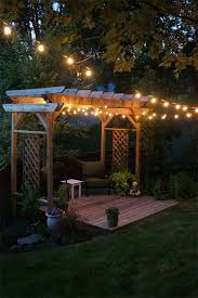 Outdoor Pergola Lights by Pergola And String Lights Our Backyard Simple Decking And