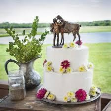 western wedding cakes cowboy and wedding cake topper western