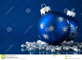 blue and silver christmas ornaments on dark blue background with