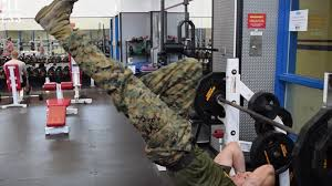 watch the things this u s marine can do on a pull up bar seem