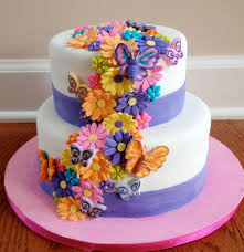 fresh flowers adorn tiered wedding cakes and often the cake can