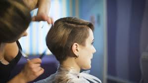 videos of girls barbershop haircuts for 2015 female hands of barber comb and cut hair of boy in barbershop