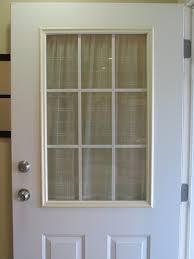 remodelaholic spray painted window trim on exterior door