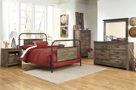 twin metal bed with reclaimed wood look rustic finish panels by