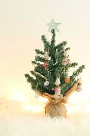 mini tree decorated with bottle brush tree ornaments and buttons
