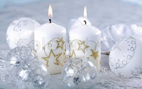 detail of christmas balls with candles in silver and white tone