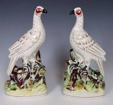 fine pair of gilt and white staffordshire bird figures in