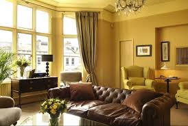 yellow gold paint color living room with brown sofa home