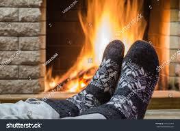 mans feet nice socks before fireplace stock photo 564223387