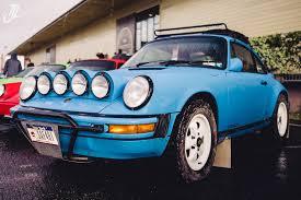 porsche rally car jump wet and wild u002791 porsche 911 safari car mic battlecars