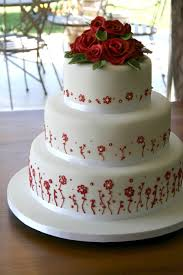 wedding cake with red piping this three tier red and black