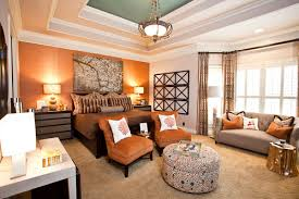 paint or wallpaper is that orange paint or wallpaper on the far wall if paint what