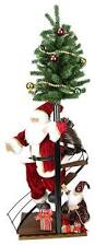 santa claus on spiral staircase with tree and elf christmas figure