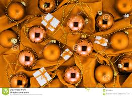 background of orange christmas tree balls little gift boxes and