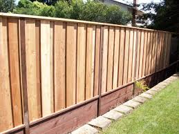 board on board fence with retaining wall and 2x6 top cap