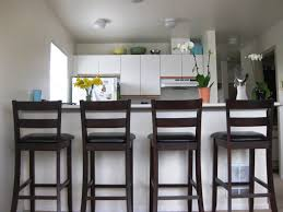 fresh idea design your high distressed copper metal counter ceiling lighting with wooden kitchen cabinet also swivel bar stools backs and white paint